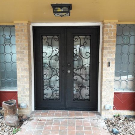 Iron Doors With Operable Glass Panels